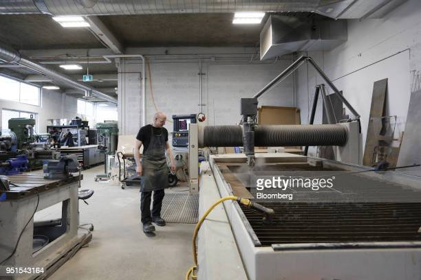 A technician operates a water jet cutter in the maker space of the Bayview Yards innovation center in Ottawa Ontario Canada on Wednesday April 25...