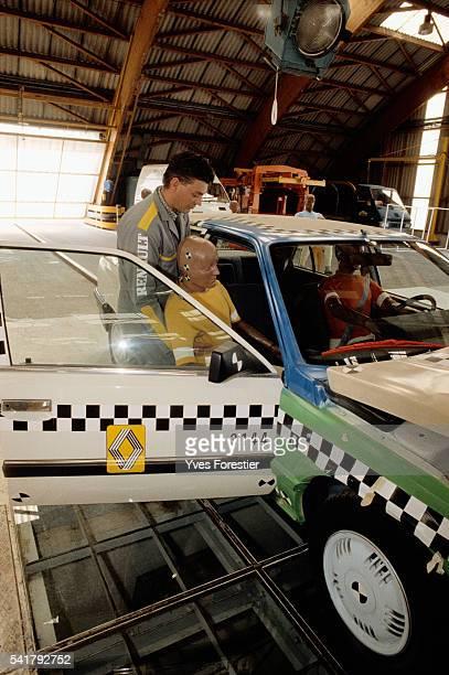 A technician prepares a crash test at the Renault technical center