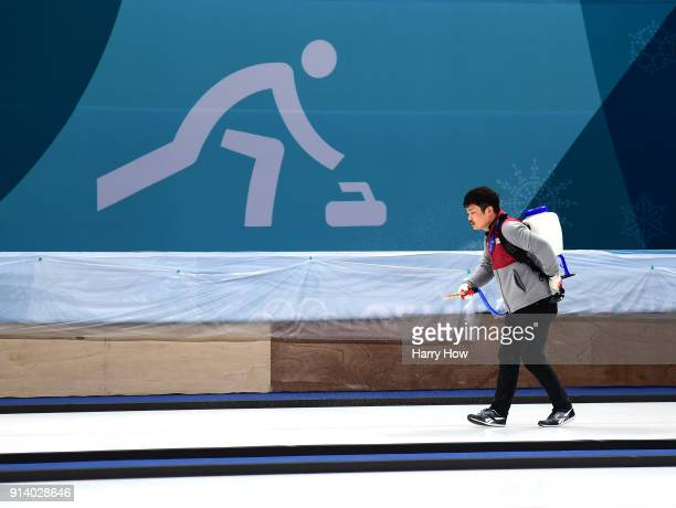 A technician prepares the ice at the Gangneung Curling Centre ahead of the PyeongChang 2018 Winter Olympics on February 4 2018 in Pyeongchanggun...