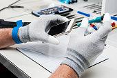 Technician repairing a smarphone