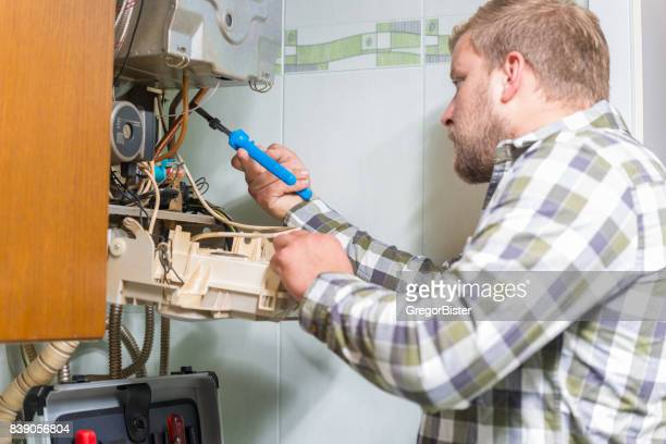 Technician repairing Gas Furnace