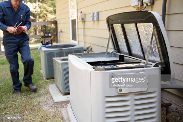 technician services outside ac units and generator. - generator stock pictures, royalty-free photos & images
