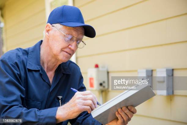 technician services outside ac units and generator. - fee stock pictures, royalty-free photos & images