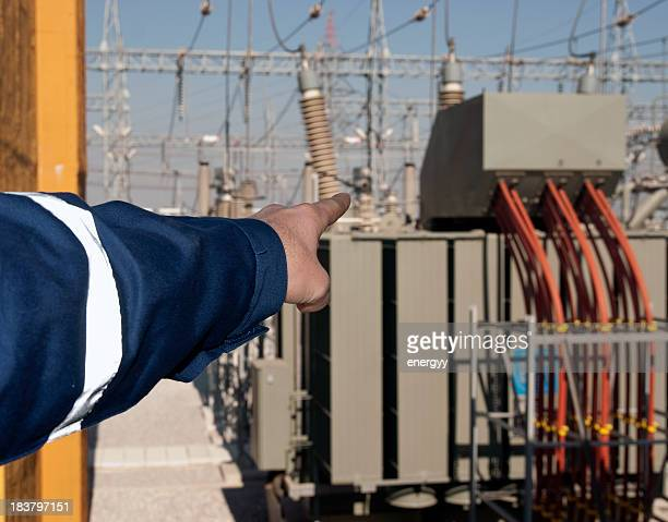 technician shows the power transformers