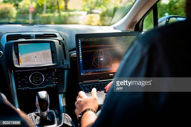 A technician sits in an Uber selfdriving car on September 13 2016 in Pittsburgh Pennsylvania Uber launched a groundbreaking driverless car service...