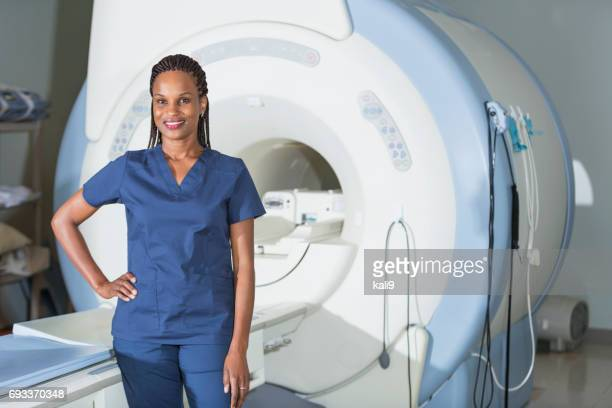 Technician standing in front of MRI scanner