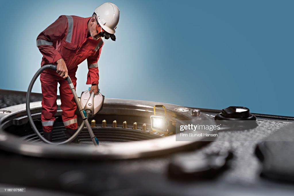 Technician standing on camera cleaning camera sensor : Bildbanksbilder