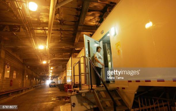 A technician stands in the doorway of a trailer where MRI scans are taken at Charity Hospital's makeshift emergency room which is located in an...