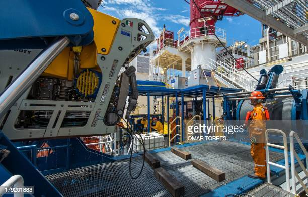 A technician surveys the maneuver on deck with the remotely operated vehicle at La Muralla IV exploration oil rig operated by Mexican company 'Grupo...