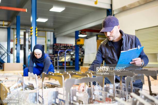 technician team make a quality control of metal pieces in a metal manufacturing company - emigration and immigration stock pictures, royalty-free photos & images
