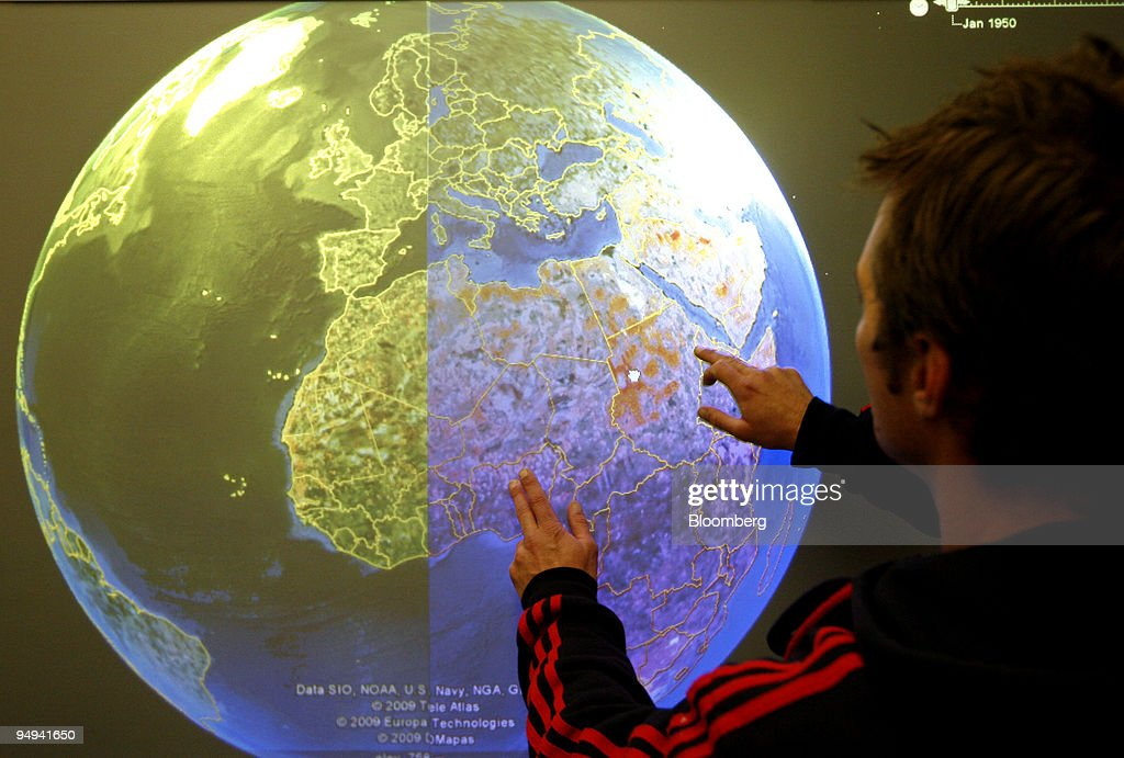 A technician tests a touch screen version of the google eart a technician tests a touch screen version of the google earth map software called touchearth gumiabroncs Gallery