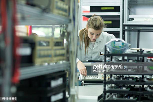 technician turning on oscilloscope - oscilloscope stock pictures, royalty-free photos & images