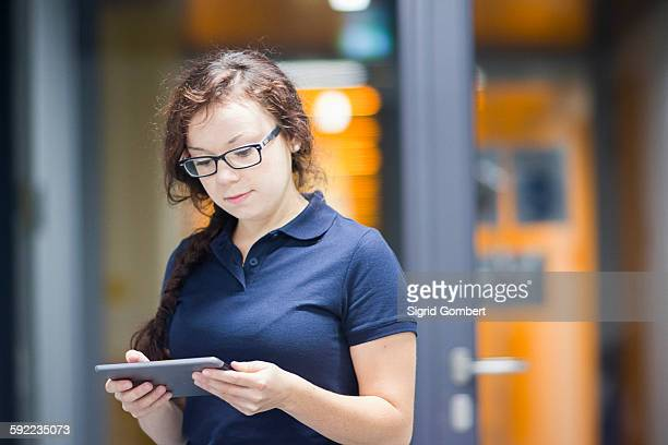 technician using digital tablet in laboratory - sigrid gombert stock pictures, royalty-free photos & images