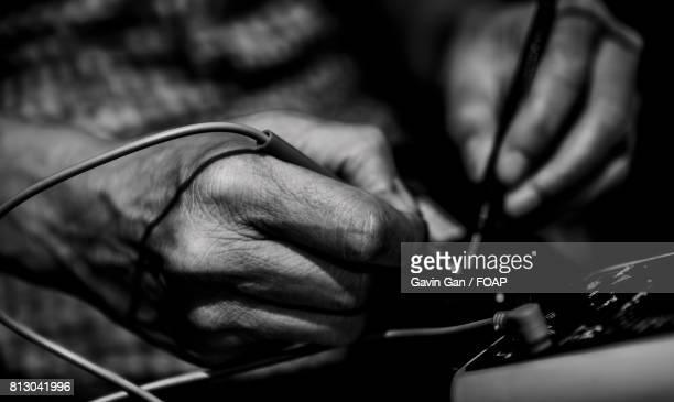 Technician using multi meter in workshop