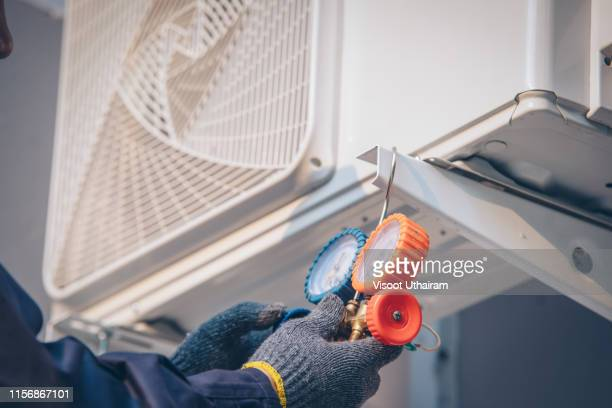 technician vacuum pump evacuates and checking new air conditioner. - air pump stock photos and pictures