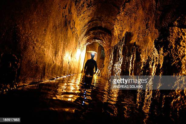 THUBURN A technician walks on October 25 2013 in the Acqua Vergine aqueduct one of the 11 roman aqueducts which supply almost all of the most...