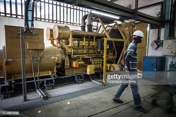 A technician walks past a diesel generator which guarantees power to the security systems at the Societe de Traitement du Terril factory in...