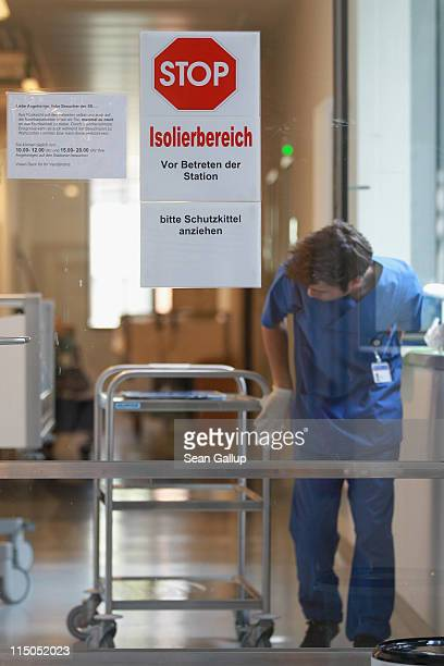 A technician wipes down a cart with disinfectant before leaving the Nephrology Unit where patients suffering from hemolyticuremic syndrome a...