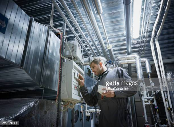 Technician with air handling and conditioning unit
