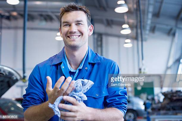 technician working in auto shop - garage stock pictures, royalty-free photos & images