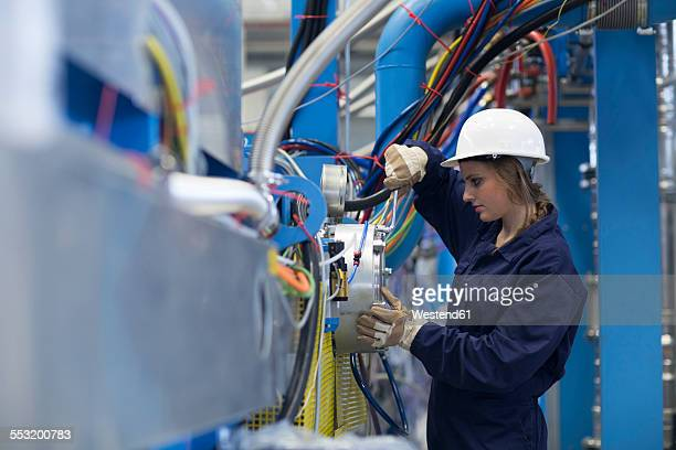 Technician working in factory hall