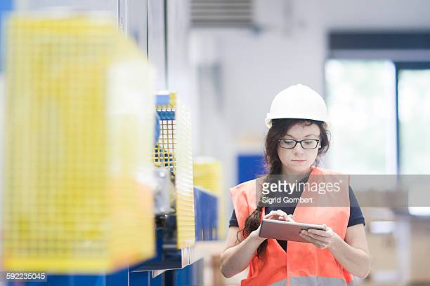 technician working in factory - sigrid gombert stock pictures, royalty-free photos & images