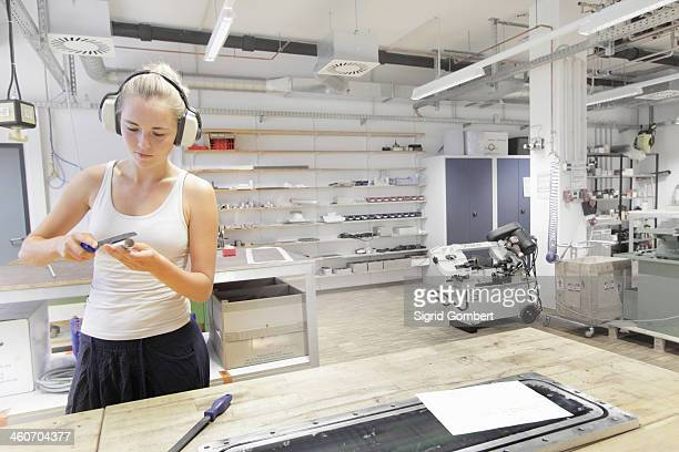 technician working in optical laboratory - sigrid gombert stock pictures, royalty-free photos & images