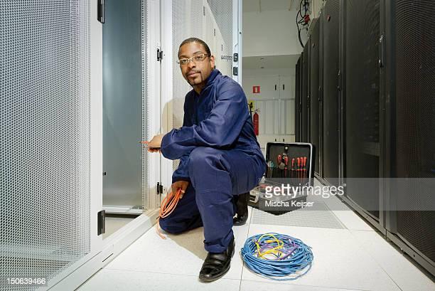 Technician working in server room