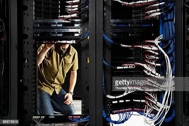 Technician working in server room.