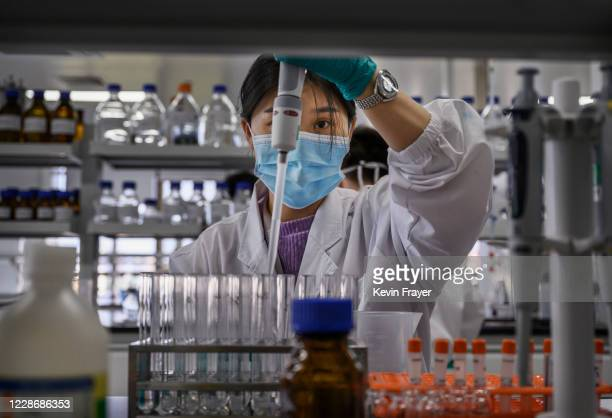 Technician works in a lab at Sinovac Biotech where the company is producing their potential COVID-19 vaccine CoronaVac during a media tour on...