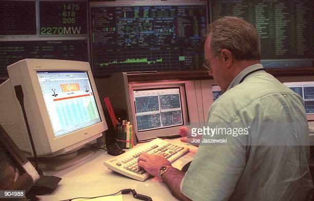 Technician works January 15, 2001 inside California's Independent System Operator facility control center located in Folsom, Ca. And which acts as a...