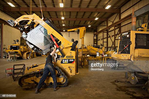 A technician works on a Caterpillar Inc 259D compact track loader at the Altorfer Cat dealership in East Peoria Illinois US on Tuesday July 21 2015...