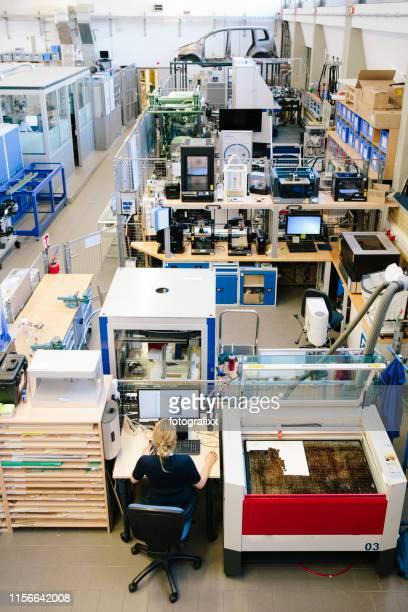 Technician Works On A Waterjet Cutting Machine By Cnc Program Stock