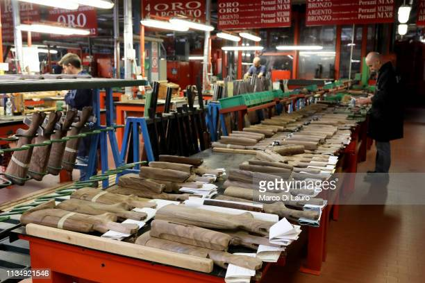 A technician works on shotgun stocks on April 4 2019 at the Perazzi Armi factory in Botticino Mattina a village in the outskirt of the city of...