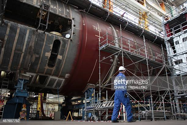A technician works on the construction of the nuclear submarine 'SNA Barracuda' in a plant of French industrial group specialised in naval defence...