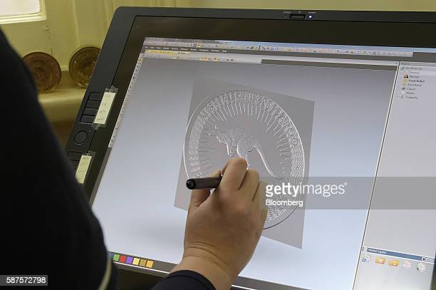 A technician works on the contouring and relief heights of a coin design using computeraided manufacturing software at the Perth Mint in Perth...