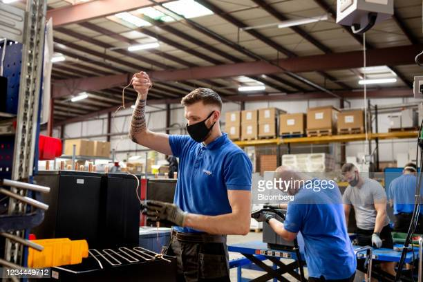 Technician works on the internal components of a Sunamp heat battery at the Sunamp Ltd. Factory in Tranent, U.K., on Monday, July 26, 2021. The...