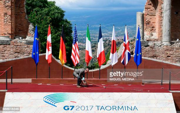 Technician works on the stage of the ancient Greek Theater where Heads of State and of Government of the G7, the group of most industrialized...