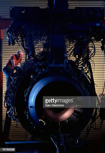 technician/engineer at jet engine plant - aircraft assembly plant stock pictures, royalty-free photos & images