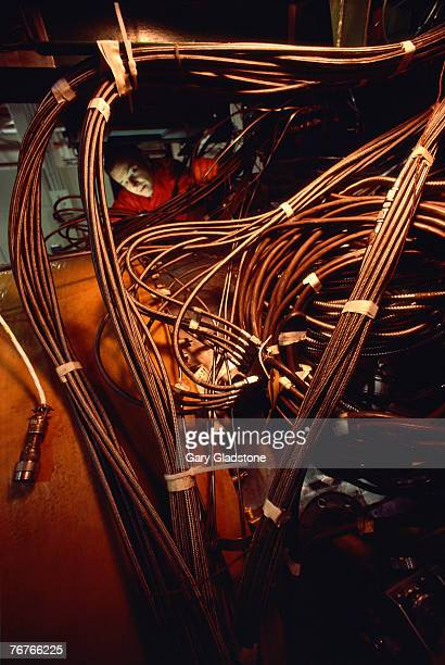 technician/engineer in jet engine manufacturing plant - aircraft assembly plant stock pictures, royalty-free photos & images