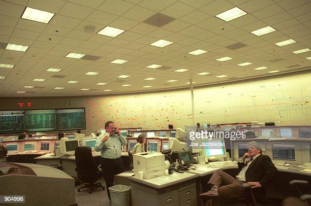 Technicians answer phones January 15, 2001 inside California's Independent System Operator facility control center located in Folsom, Ca. And which...