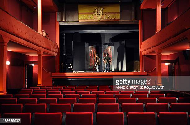 Technicians are at work on October 4 2013 in the projection room of the world's oldest cinema L'Eden in La Ciotat southern France L'Eden cinema which...