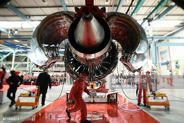 Technicians are pictured around a LEAP1A engine developed by CFM a joint venture between France's Safran and General Electric during its handover...