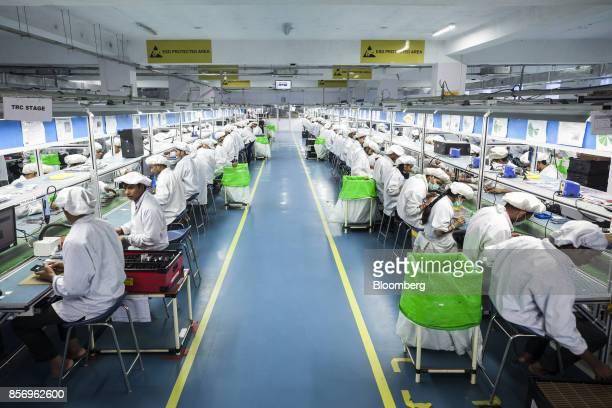 Technicians assemble smartphones on the production line inside the Intex Technologies India Ltd plant in Noida Uttar Pradesh India on Friday Sept 29...