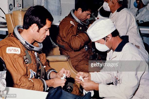 Technicians assist astronauts John Young and Robert Crippen in suitup operations in Kennedy's Operations and Checkout Building on the morning of...