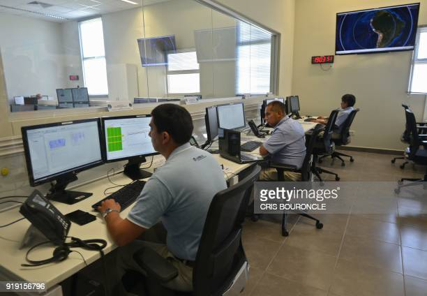Technicians at the National Satellite Image Operation Centre in Pucusana Peru some 60 kilometers south of Lima monitor and command the PeruSAT1...