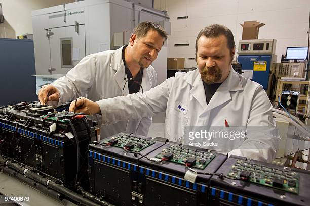 Technicians at work in auto battery lab