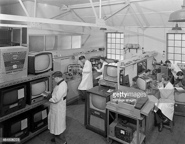 Technicians at work in Clays TV repair in shop Mexborough South Yorkshire February 1959