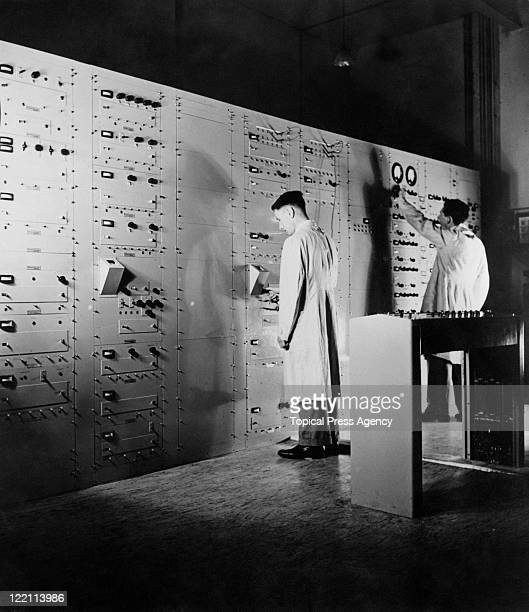 Technicians at work on a MarconiEMI system in the control room at the BBC's first high definition television station at Alexandra Palace London 23rd...