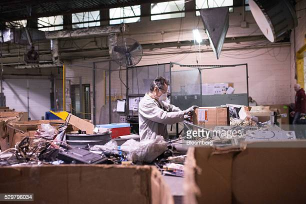 Technicians break down electronics for recycling at the ADL Process Inc secondary facility in Toronto Ontario Canada on Monday May 2 2016 ADL Process...